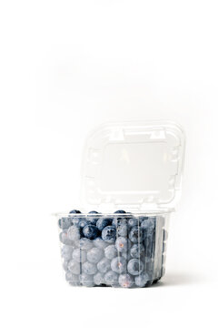 clear blueberry jar, on white background, with open lid, side view, vertical format