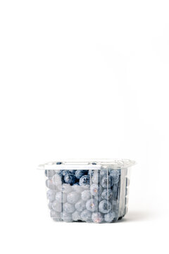 transparent blueberry jar, on white background, with closed lid, front view, vertical format