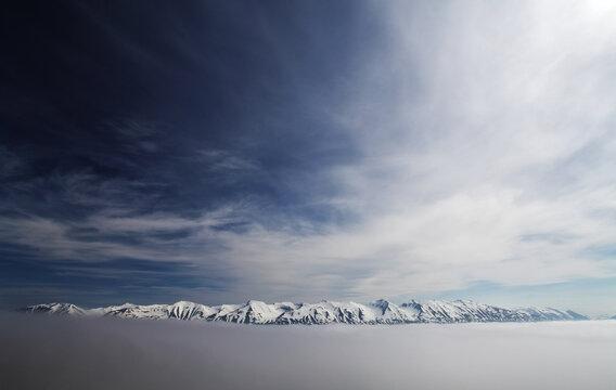 Winter mountain sky snow