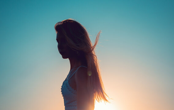 silhouette of a woman on sunset