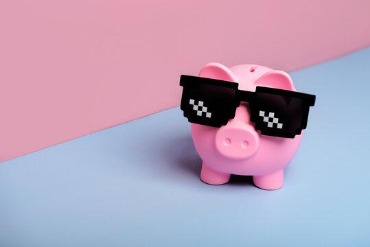 Pink piggy money bank with black sunglasses