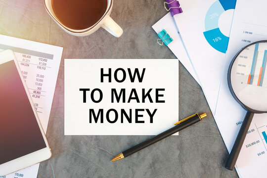 How to make money is written in a document on the office desk, coffee, diagram and smartfon