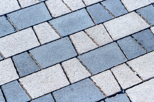 Grey paving stones as background texture