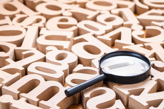 Magnifying on English Wood Alphabets