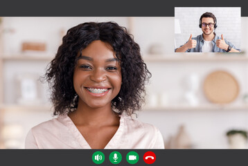 Man And Black Woman Having Online Video Call