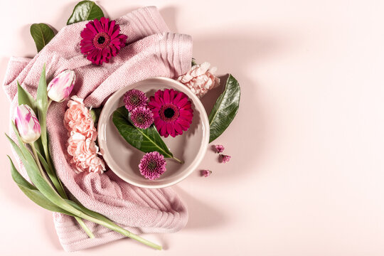 Spa background with flowers and towel, copy space