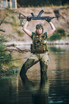 Water survival training. Female military army soldier with machine gun. Shooting and weapons. Outdoor shooting range