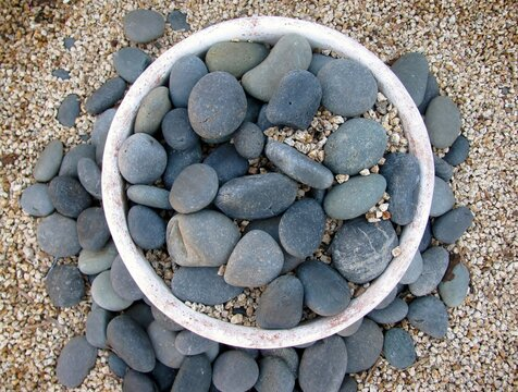 Top view of modern natural pebble fire pit.