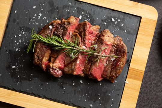 Closeup grilled Argentine beef chorizo bife top view.