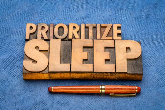 prioritize sleep - word abstract in vintage letterpress wood type, healthy lifestyle concept