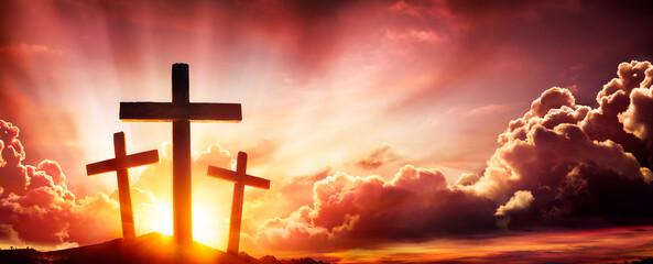 Crucifixion Of Jesus Christ- Three Crosses As Sunset