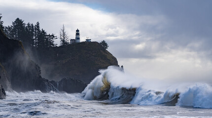 Huige waves crashing on the headland under Cape Disapointment lighthouse near the mouth of the Columbia River, Ilwaco, Washington