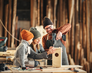 Obraz Kid with parents assembling wooden bird house in craft workshop - fototapety do salonu