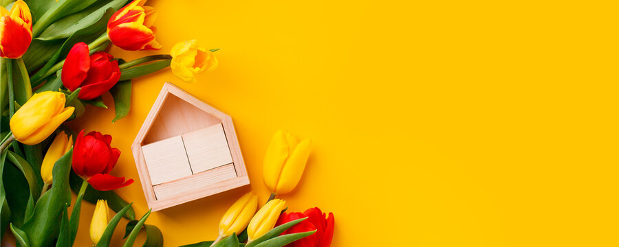 Greeting card mockup. Bouquet of colorful tulip flowers and wooden calendar, copy space, invitation card. Spring concept, seasonal holiday, 8 march International woman day, Mother day, banner