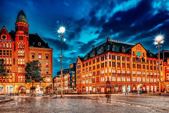 AMSTERDAM, NETHERLANDS - SEPTEMBER 15, 2015: Beautiful Amsterdam, centre of  Dam Square in the evening. Square is a central place for local inhabitants and tourists of the Dutch capital.