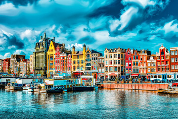 "AMSTERDAM, NETHERLANDS - SEPTEMBER 15, 2015: Beautiful views of the streets, ancient buildings, people in Amsterdam - also call ""Venice in the North""."
