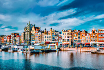 "AMSTERDAM, NETHERLANDS - SEPTEMBER 15, 2015: Beautiful views of the streets, ancient buildings, people, embankments of Amsterdam - also call ""Venice in the North"". Netherlands"