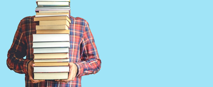 Student with books on a blank colored banner background. Education, reading and study background concept.