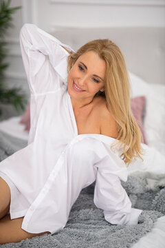 Beautiful adult woman in morning on bed