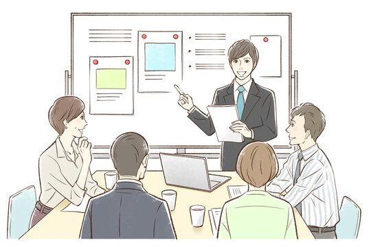 男性中心にホワイトボードの前でグループでミーティング