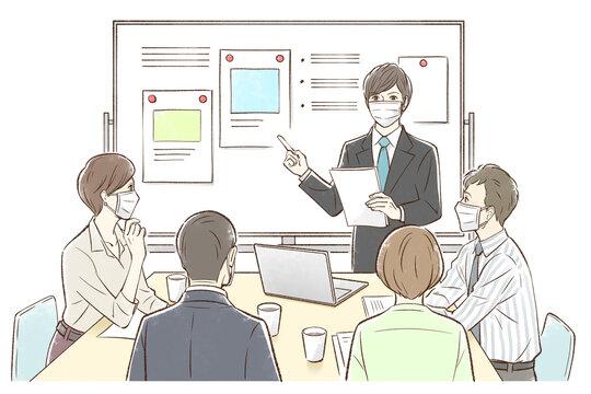 男性中心にホワイトボードの前でグループでミーティング_マスクあり