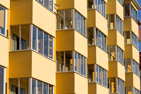 Close-up of a new apartment building balconies. Residential modern multi story building detail image.