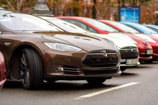 Kyiv, Ukraine - July 12, 2020: Tesla electric car parled on a street.