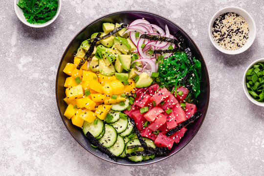 Hawaiian tuna poke bowl with seaweed, avocado, mango, cucumber.