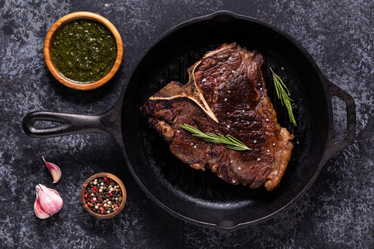 Grilled beef steak with spices in a frying pan