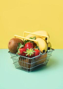 Shopping basket with fresh fruits