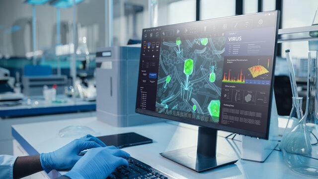 Modern Medical Laboratory: Scientist Wearing Surgical Gloves, Working on Computer, Scren Shows Virus Research Software. Advanced Scientific Lab, Medicine Biotechnology Development