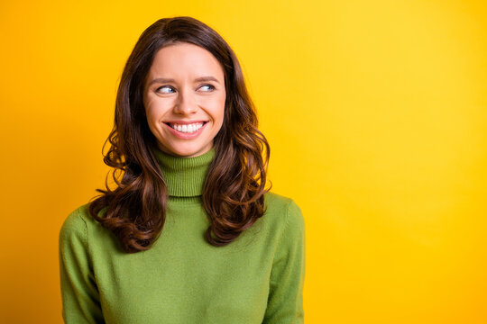 Portrait of young beautiful cheerful smiling good mood positive charming woman look copyspace isolated on yellow color background