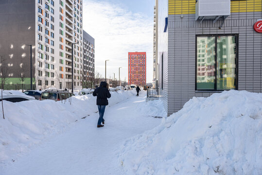 Moscow. Russia. February 2021. Cleared the snow from the paths after a huge snowfall. Deep walking paths in Moscow.