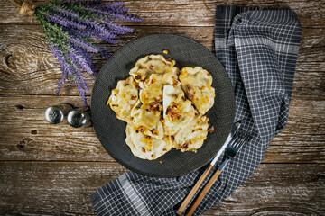 Fried dumplings (pierogi) with spinach.