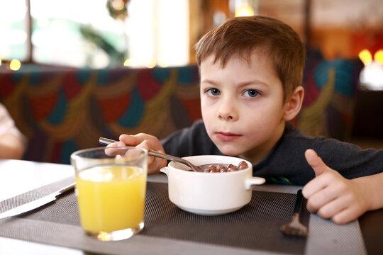 Child has breakfast in restaurant