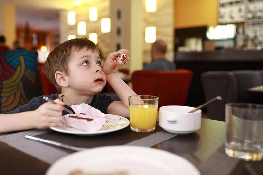Child has dessert for breakfast