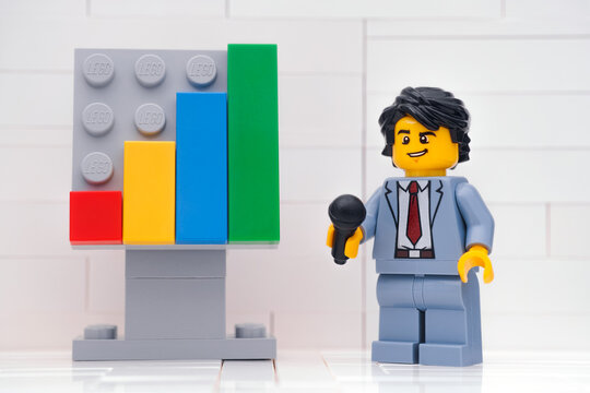 Tambov, Russian Federation - January 13, 2021 Lego entrepreneur minifigure using microphone and discussing the results of successful teamwork.