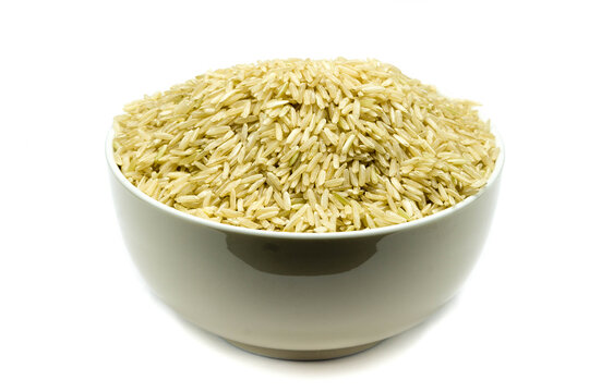 Brown rice in bowl isolated on white background