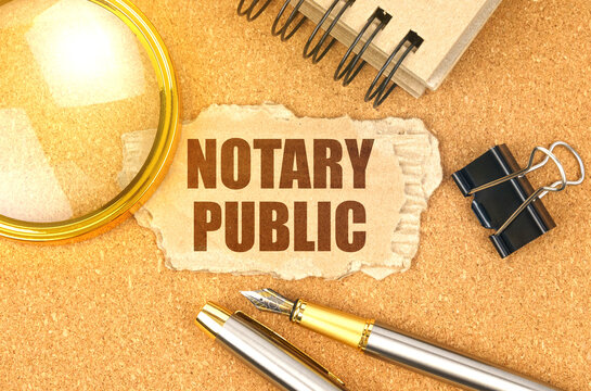 On the table are office items and a cardboard with the inscription - NOTARY PUBLIC