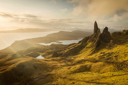 Landscape view at sunset with colourful clouds of Old Man of Storr rock formation, Scotland, United Kingdom.