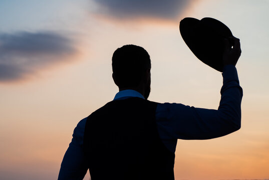 Real freedom. agile business. loneliness. need the inspiration. man feel motivation. businessman in hat silhouette on sky background. confidence and success. concept of successful future