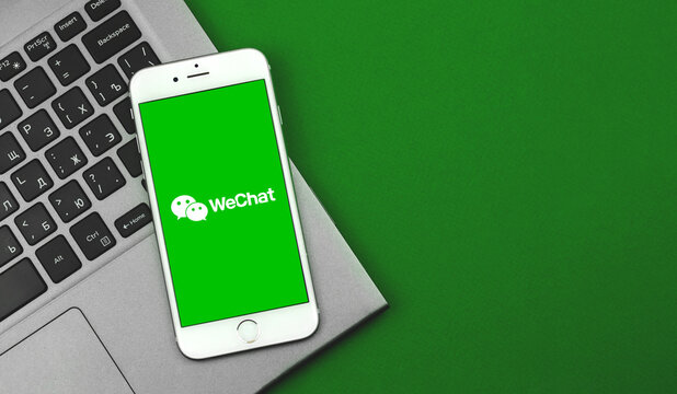 Kharkov, Ukraine - February 25, 2021: WeChat application on Apple iPhone screen, chinese social network flat lay banner, copy space