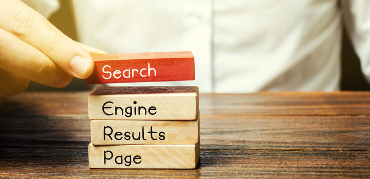 Wooden blocks with the word SERP - Search Engine Results Page. Pages displayed by search engines in response to a query by a user. Internet technology concept. Organic and sponsored search