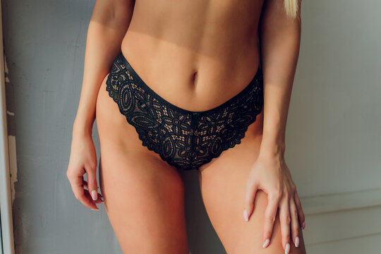 Fitness as a lifestyle. Close up of fit female body standing in comfortable lingerie.