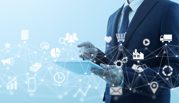 Marketing and network technology. Businessperson using tablet computer. Network structure and business icons.