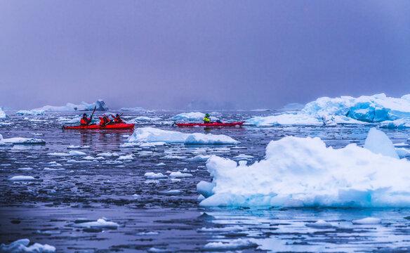Snowing Red Kayaks Iceberg Paradise Harbor Antarctica