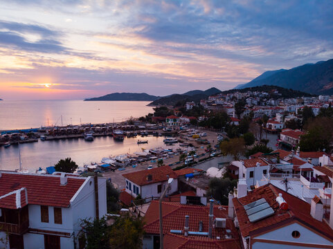 View from drone of small Turkish town of Kas on Turquoise Coast of Aegean Sea overlooking embankment and marina