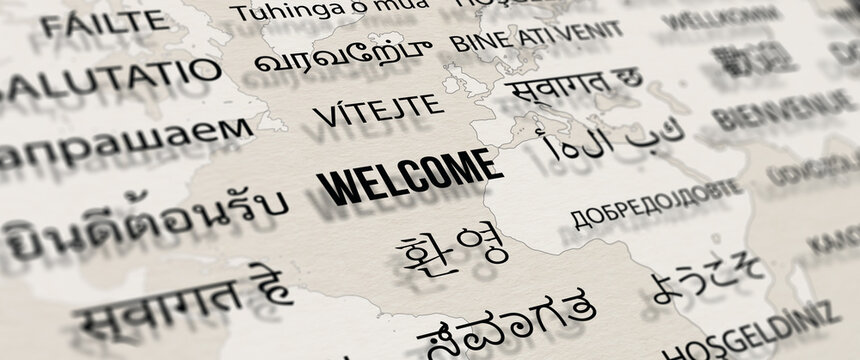 Welcome in different language on paper with world map background. Depth of field image. Words cloud concept.