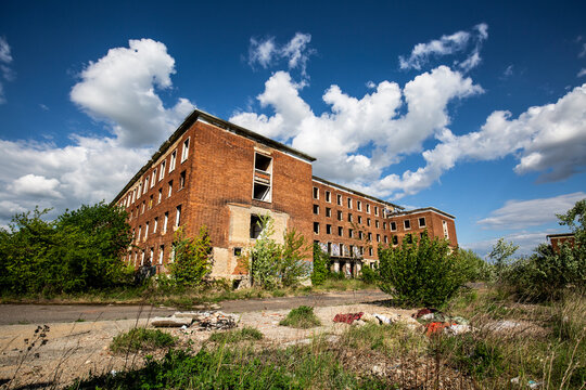 Abandoned brick building at blue sky