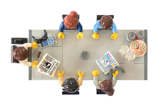Lego minifigures at business meeting on table view above. Editorial illustrative image of people are planning in office after pandemy.